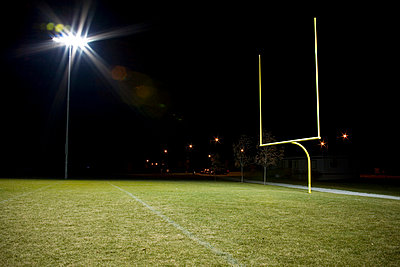 Football field at night - p3722236 by Michael Rastall