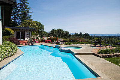Swimming pool overlooking rural landscape - p555m1420366 by Tanya Constantine
