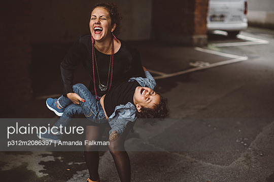 Happy mother with son - p312m2086397 by Amanda Falkman