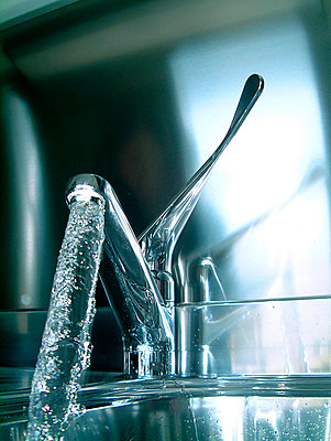 Water Pouring Out Of Kitchen Faucet - p6943102 by Per Zennström
