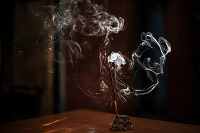 Incense stick burning - p1007m2099032 by Tilby Vattard