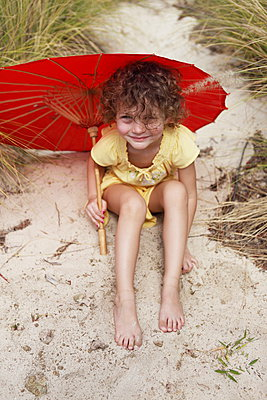 Little girl with a parasol - p045m925802 by Jasmin Sander