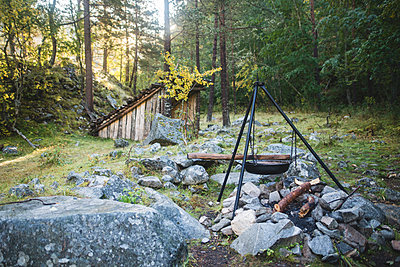 Cooking pot on tripod above campfire - p1427m2169346 by Oleksii Karamanov