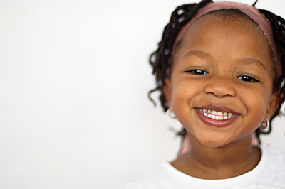 Off center portrait of young girl - p3720390 by James Godman
