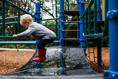 Toddler boy skipping in the playground - p1238m1462498 by Amanda Voelker