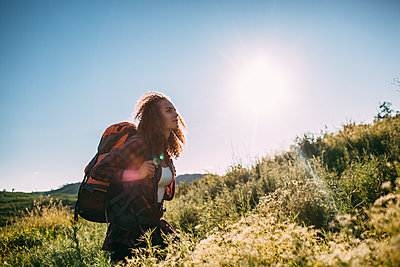 Teenage girl with backpack in nature - p300m1505473 by Vasily Pindyurin