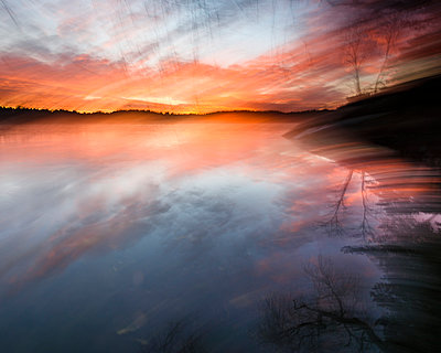 Lake at sunset - p312m1495278 by Mikael Svensson