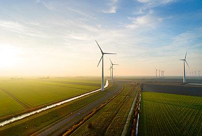 Wind farm at sunrise - p1132m2038593 by Mischa Keijser