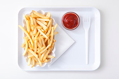 French fries with ketchup - p4541065 by Lubitz + Dorner