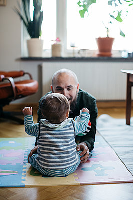 Father with baby - p312m2139450 by Amanda Falkman