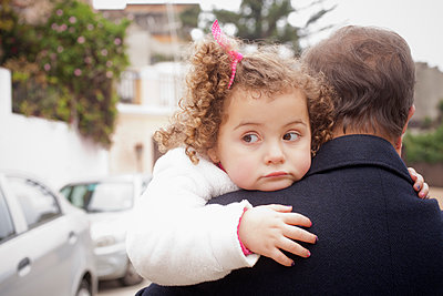 Girl being carried by her father - p1427m2077556 by REB Images
