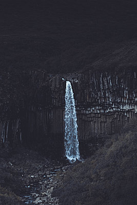 Waterfall surrounded by basalt colums - p1634m2210365 by Dani Guindo