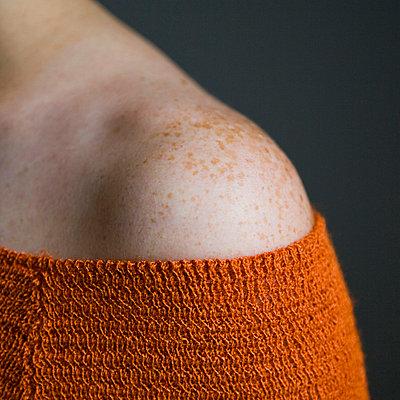 Shoulder with freckles - p4263725f by Tuomas Marttila