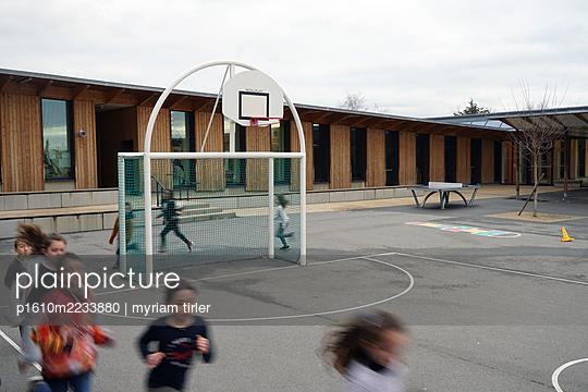 a school teacher gives a sport class in the recreation yard - p1610m2233880 by myriam tirler