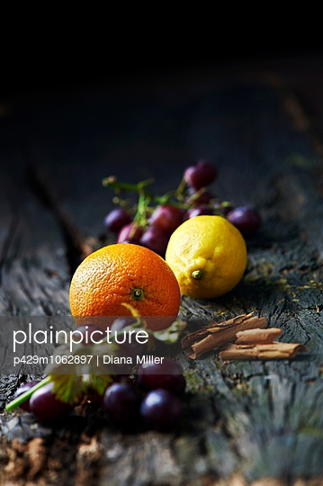 Fruits and spices on old wooden surface