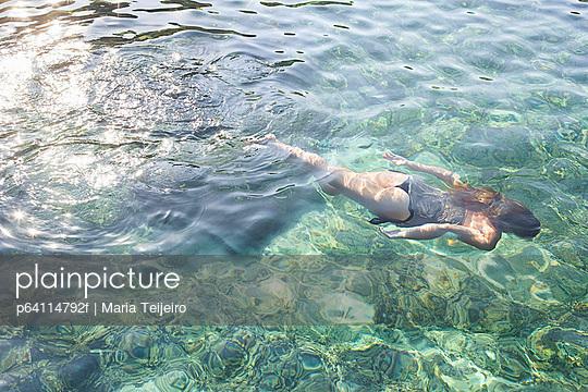 Woman diving in tropical ocean