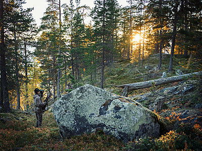 Man hunting in forest - p312m1558502 by Johner