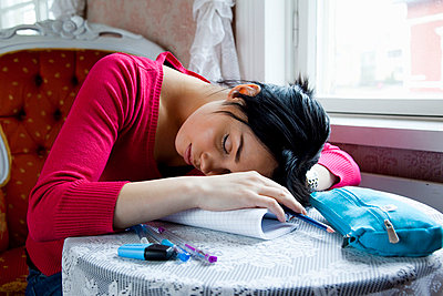 Young woman sleeping - p4130343 by Tuomas Marttila