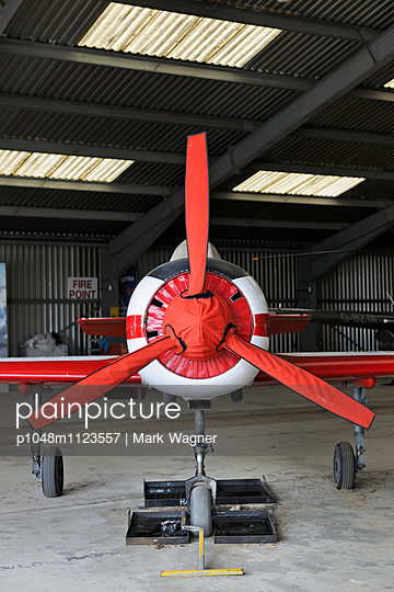 Light Airplane red propeller cover - p1048m1123557 by Mark Wagner
