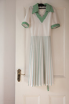 Retro Dress Hanging on Door - p1248m1573434 by miguel sobreira