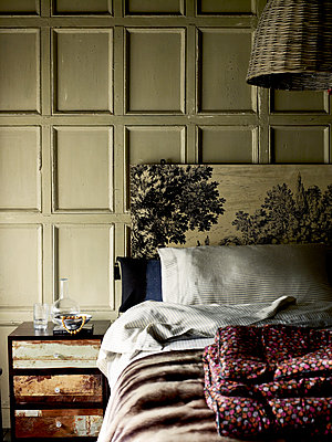 Vintage headboard with side cabinet in panelled 'filmic style' bedroom - p349m2167823 by Polly Wreford