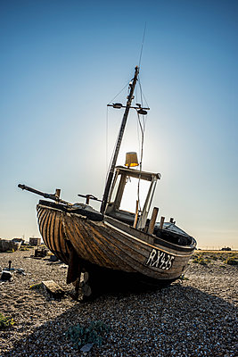 Old boat on a shingle beach; Dungeness, Kent, England - p442m1086804 by Dosfotos