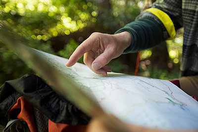 Close up man checking hiking map - p1192m1149439 by Hero Images