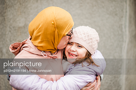 Mother with daughter hugging - p312m2191194 by Anna Johnsson