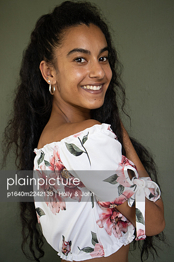 Black-haired woman in a flower top - p1640m2242139 by Holly & John
