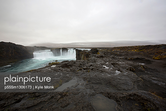 Rock formation cliffs near remote waterfall - p555m1306173 by Kyle Monk
