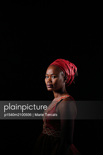 Portrait of a black woman with a red dress  - p1540m2100936 by Marie Tercafs