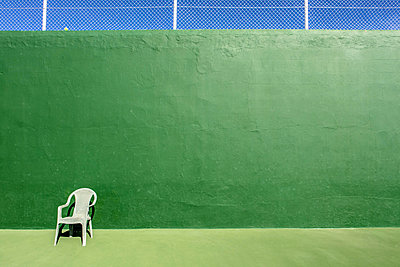 Chair on tennis courd - p1082m1538991 by Daniel Allan