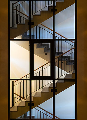 stairwell illuminated at night - p1280m2203323 by Dave Wall