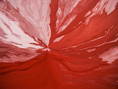 Aerial view of red abstract patterns in Mississippi River - p1166m2025541 by Cavan Images