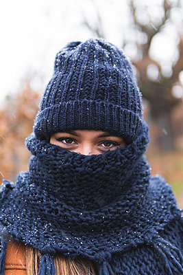 Young woman in knit hat and scarf outdoors - p300m2242768 by Josu Acosta