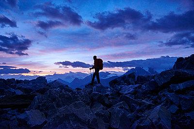 Hiker at dusk, Mont Cervin, Matterhorn, Valais, Switzerland - p429m2058448 by Jakob Helbig
