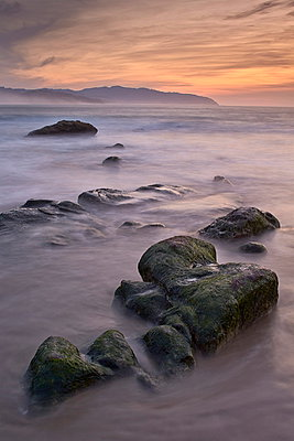 Rocks at sunset, Pacific City, Oregon, United States of America, North America - p871m947399 by James Hager