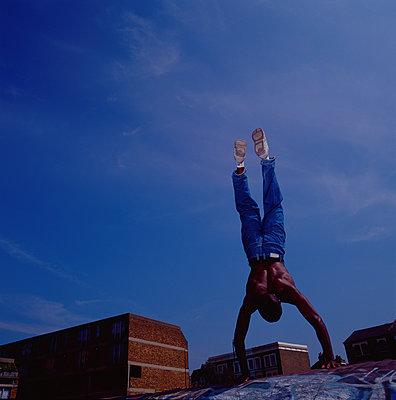 Handstand in a skate park - p1082m2196347 by Daniel Allan