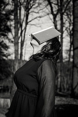 Woman with book on her face - p1621m2254230 by Anke Doerschlen