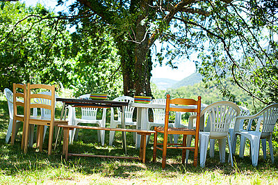 Table under a tree - p1007m853552 by Tilby Vattard