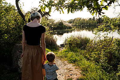 Woman and son near river - p1363m2134668 by Valery Skurydin