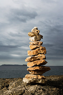 Stacked stones near sea - p31226575f by Roine Magnusson