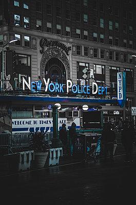 New York Police Department Sign at Night, New York City, New York, USA - p694m1192926 by Eric Schwortz
