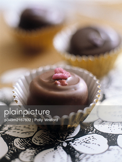 Chocolate truffle on floral tray - p349m2167832 by Polly Wreford