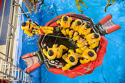 Oil workers learning survival strategies - p429m768897f by Monty Rakusen