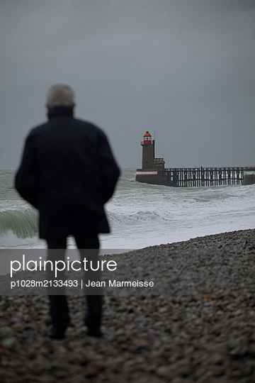 Old man looking at the sea - p1028m2133493 by Jean Marmeisse