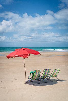 Canvas chairs on sandy beach - p1170m1111641 by Bjanka Kadic
