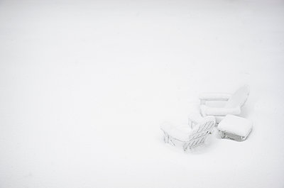 Outdoor chairs and table covered with snow - p1427m2254887 by Chris Hackett