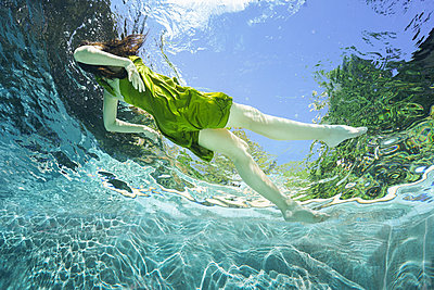 underwater ballet dancer woman  - p1554m2159070 by Tina Gutierrez