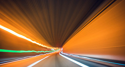 Long exposure of motorway tunnel at night - p300m978102f by Florian Löbermann